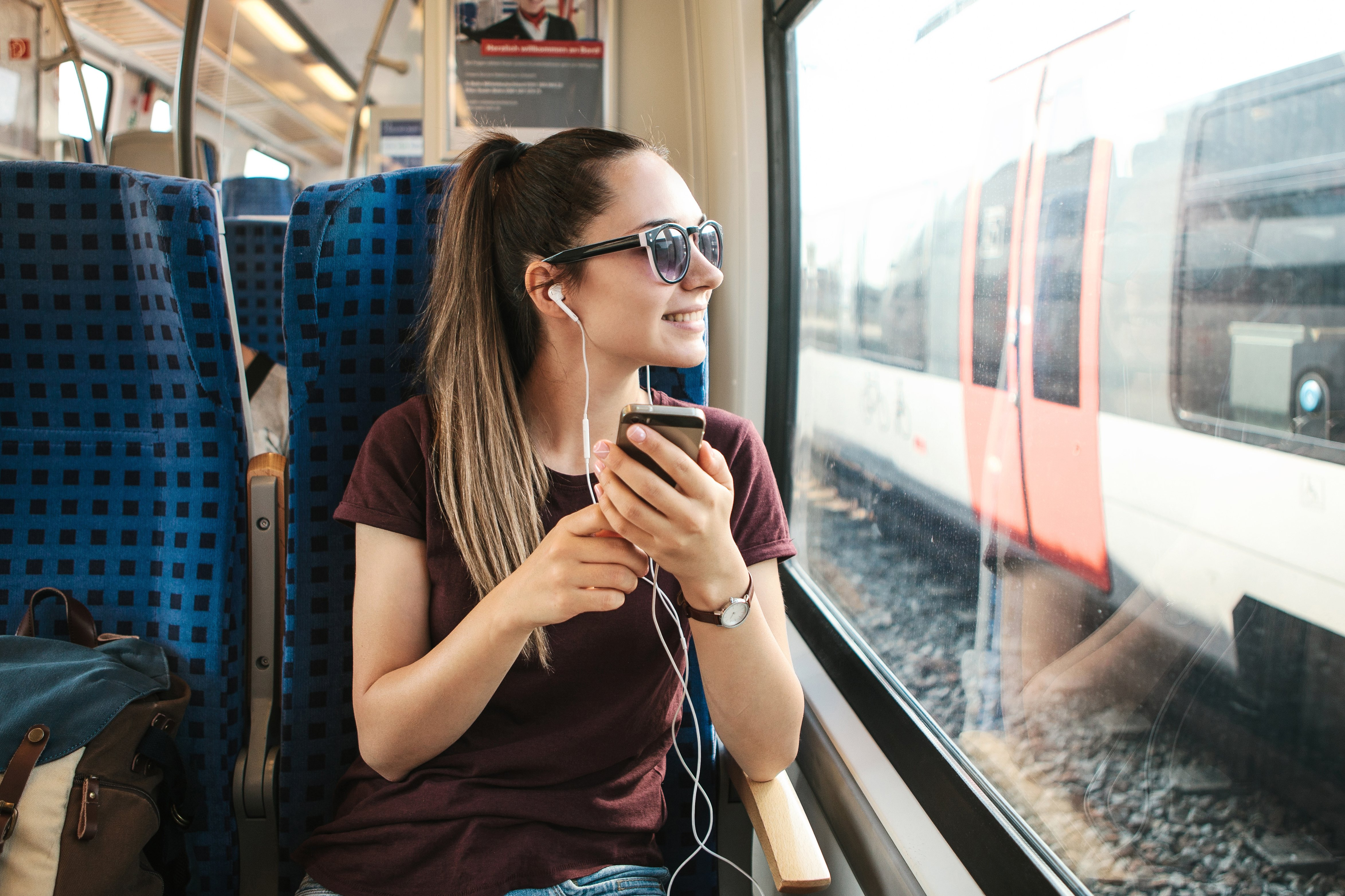 7 Podcasts to Listen to On Your Next Trip