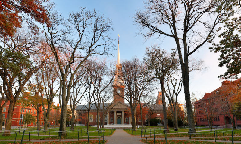 Memorial Church and Harvard Yard on campus of Harvard University at sunset. Harvard University is a private Ivy League research university in Cambridge, MA.